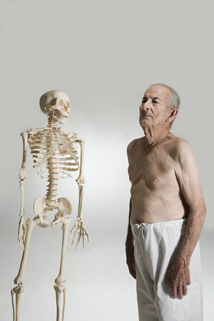 Senior man and a skeleton
