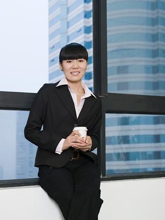 Businesswoman with coffee Stok Fotoğraf