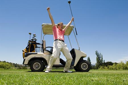 A golfer cheering