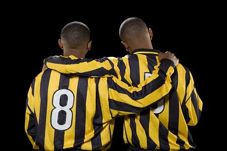 Rear view of footballers