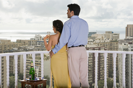 Rear view of a couple on a balcony