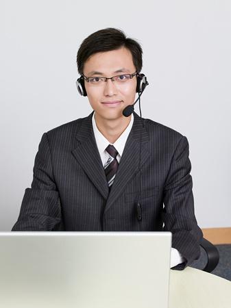 Businessman wearing headset Foto de archivo