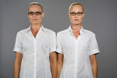Twin sisters wearing glasses