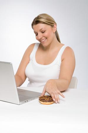 A woman holding a doughnut