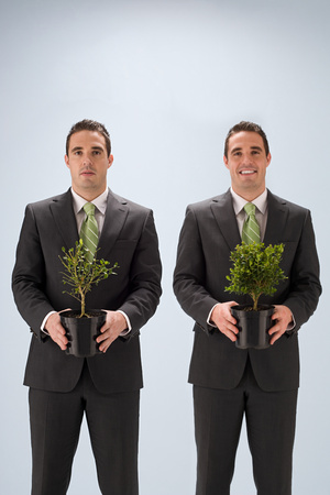 Businessmen with plants Foto de archivo