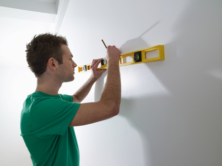 A man using a spirit level
