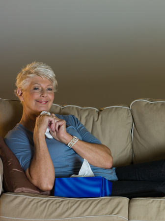 A senior woman watching tv