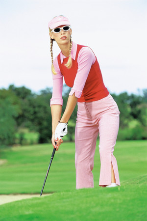 Vrouw golfen
