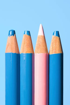 Pink pencil with blue pencils