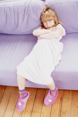 Girl sulking on sofa