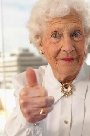 Elderly woman giving the thumbs up Archivio Fotografico