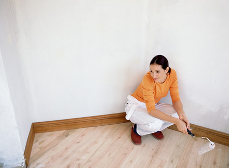 Woman decorating with roller