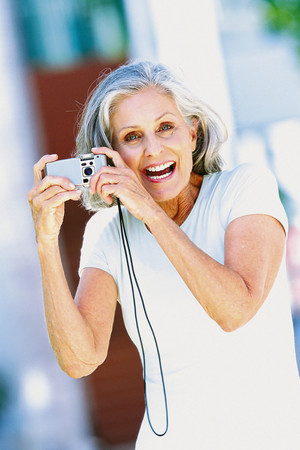 Ageing woman with camera