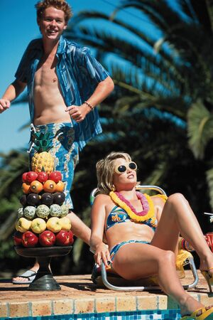 Fruit and sunbathing by the pool