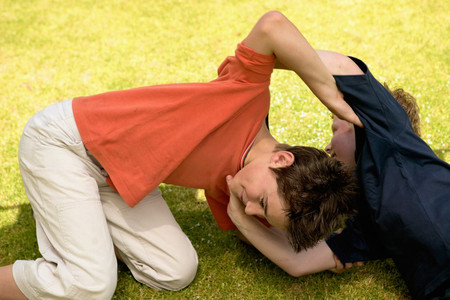 Boys play at wrestling Stockfoto