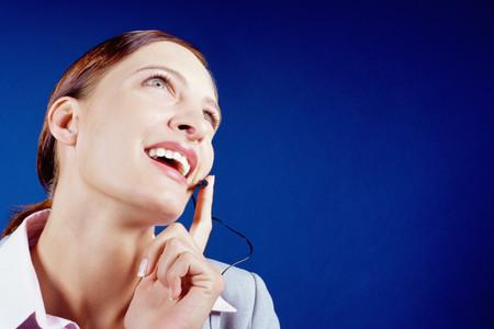 Businesswoman using telephone headset
