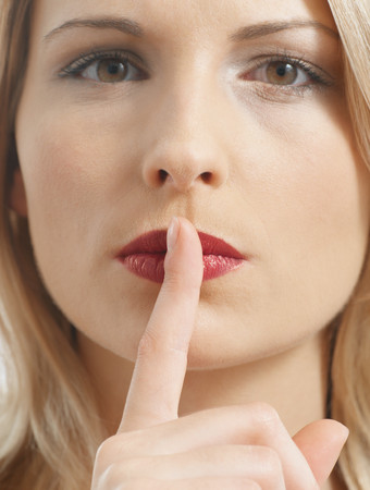 Woman putting a finger to her lips