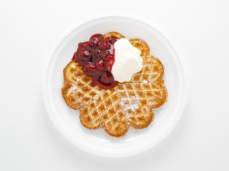 Waffle with cherries and cream Stock Photo