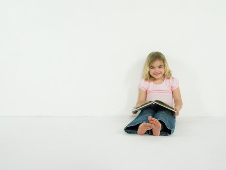 Little girl with picture book