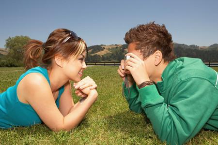 Man taking a photograph of his girlfriend 版權商用圖片