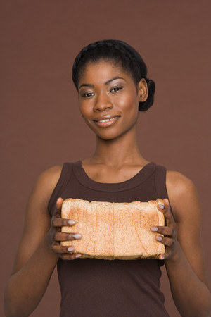 Young woman holding a loaf of bread