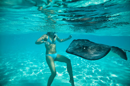 Woman Snorkeling With Stingray