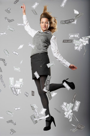 Woman Jumping With Bank Notes
