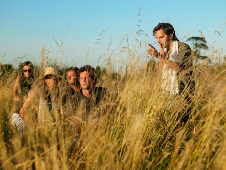 People In A Safari With Guide Stock Photo