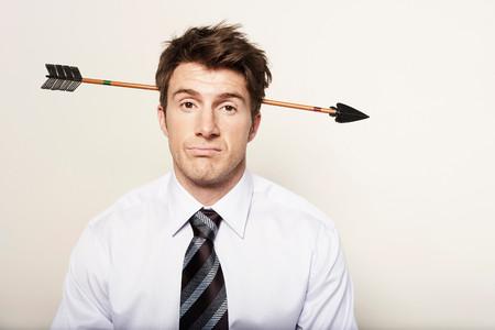 Business Man With Arrow Through Head