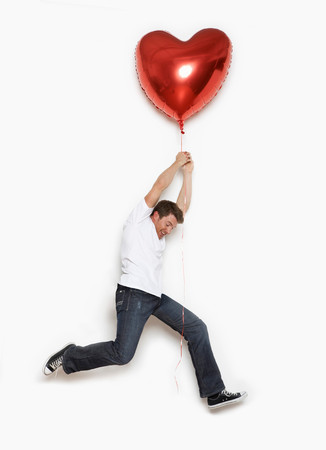 Man Lifted By Heart Balloon