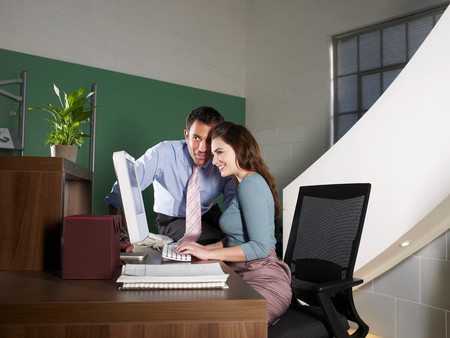 Office Receptionist With Male Worker