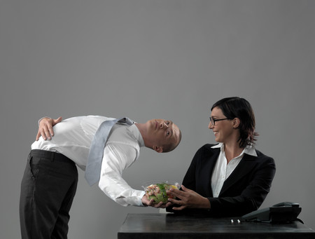 Business Man Serving Lunch To Colleague