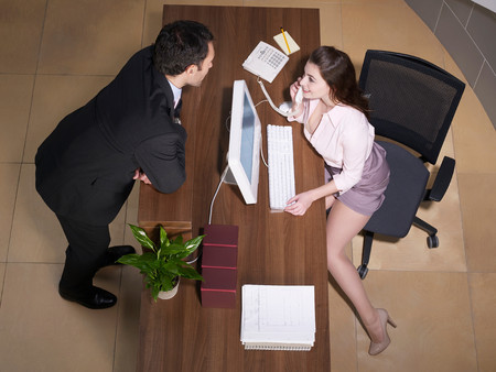 Receptionist And Businessman Flirting
