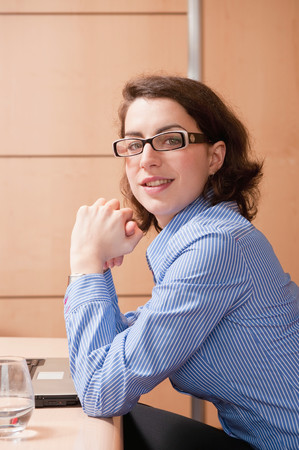 Young Businesswoman Looking Into Camera Stock Photo