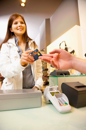 Paying Shoes By Credit Card Stock Photo