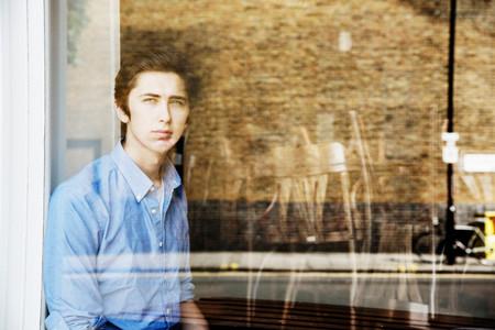 Teenage Boy Looking Out Window