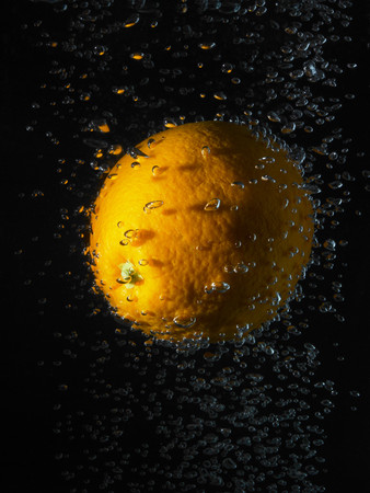 Orange In Bubbles, Black Background