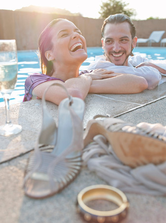Couple In Swimming Pool, Dressed Stock Photo