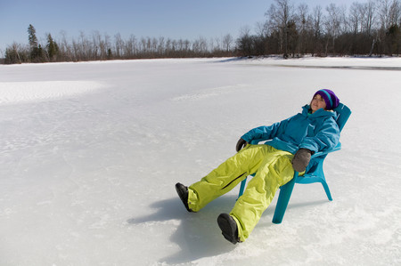 Woman Relaxing On Frozen Lake