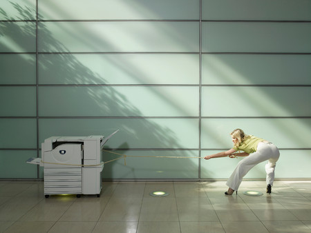 Woman Pulling A Copier Standard-Bild