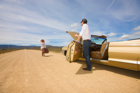 Couple With Car Trouble In Desert