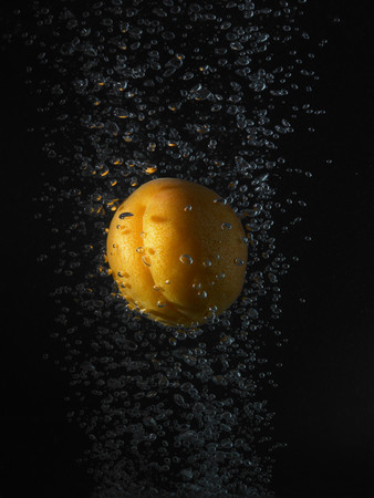 Apricot In Bubbles, Black Background Imagens