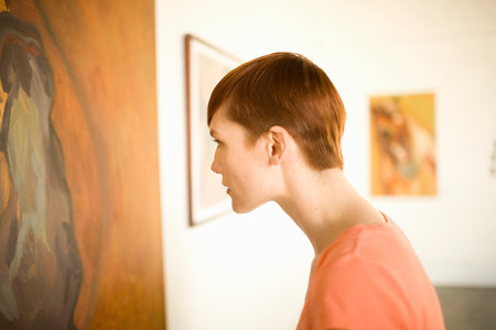 Woman In Art Museum Looking At Painting