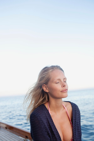 Woman With Closed Eyes On A Sailing Boat
