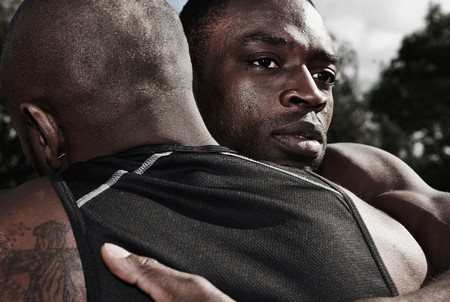2 Male Athletes Embrace