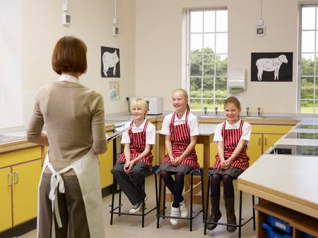 Teacher With Three Children Banque d'images