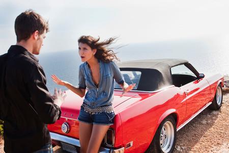 Couple Arguing Next To Car Imagens