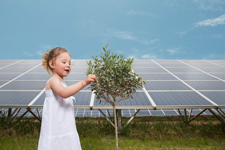 Girl And Tree In Front Of Solar Panel
