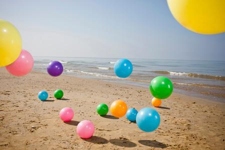 Colorful Beach Balls Bouncing On Sand Reklamní fotografie