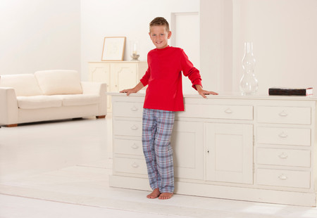 Boy In Pajamas Leaning On Desk